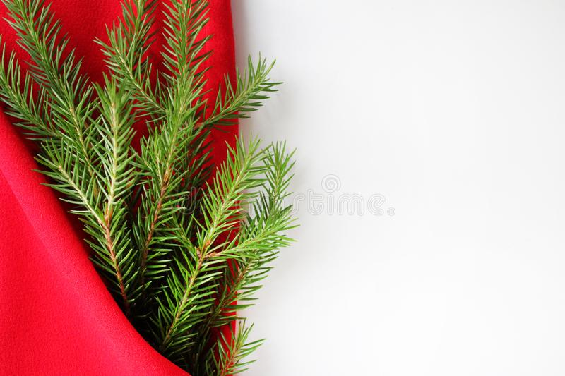Christmas card background. New year holiday. Christmas still life. The view from the top. Free space for text. Green pine branches. On a red background stock images