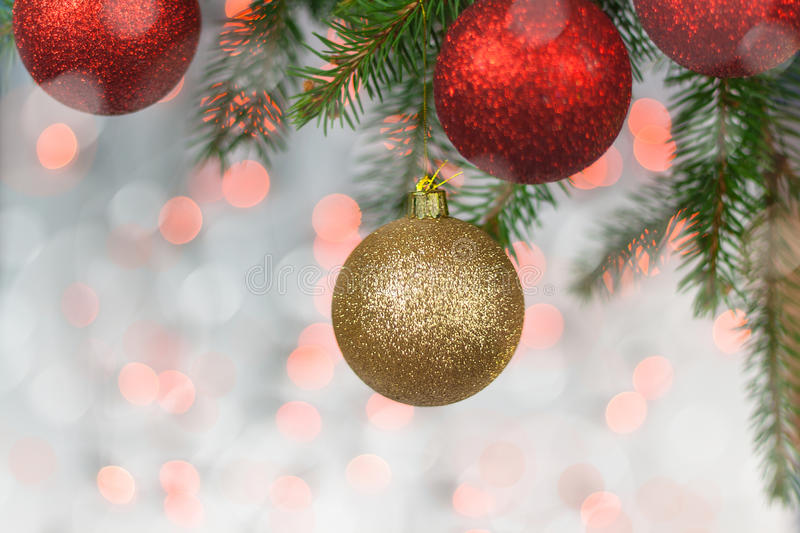 Christmas card with balls and spruce twig royalty free stock images