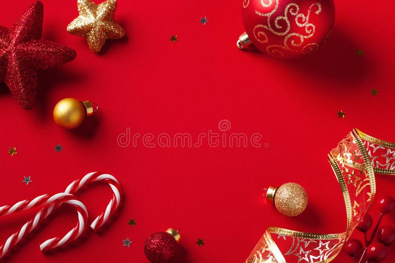Christmas card or banner. Christmas decorations on red background royalty free stock photo