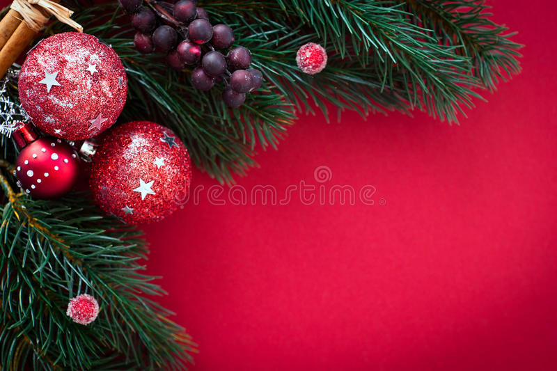Christmas Card With Baubles And Fir Tree On Red Royalty Free Stock Image