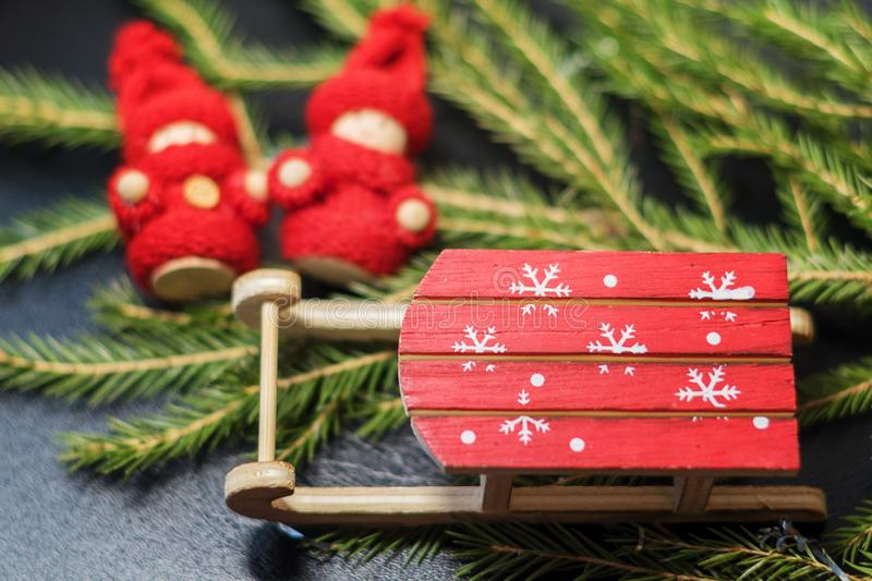 Wooden Toy Sled And A Hat Of Santa Claus And Christmas Cookies
