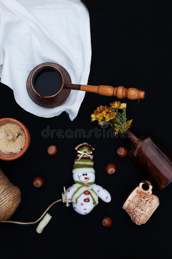 Christmas card with coffee and snowman. Cup of hot drink. Holiday Christmas concept. Nuts, a bouquet of flowers, Christmas toy sno stock image