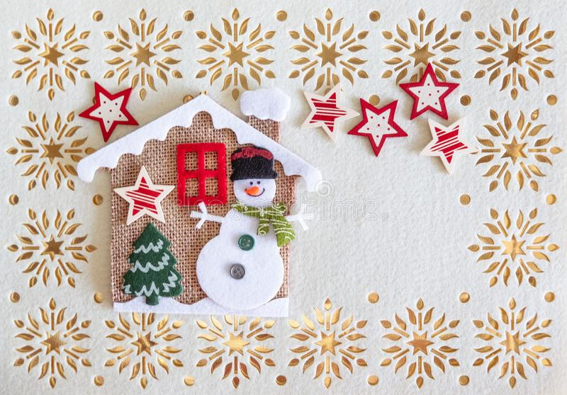 Christmas Card with Copy Space, Decoration made of Snowman with Tree and Stars in a little House stock illustration