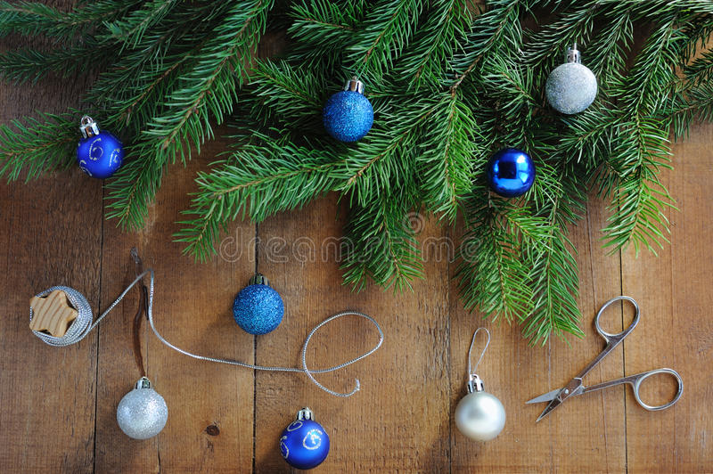 Christmas Card with decorations - silver thread, scissors, xmas tree and color balls. stock images