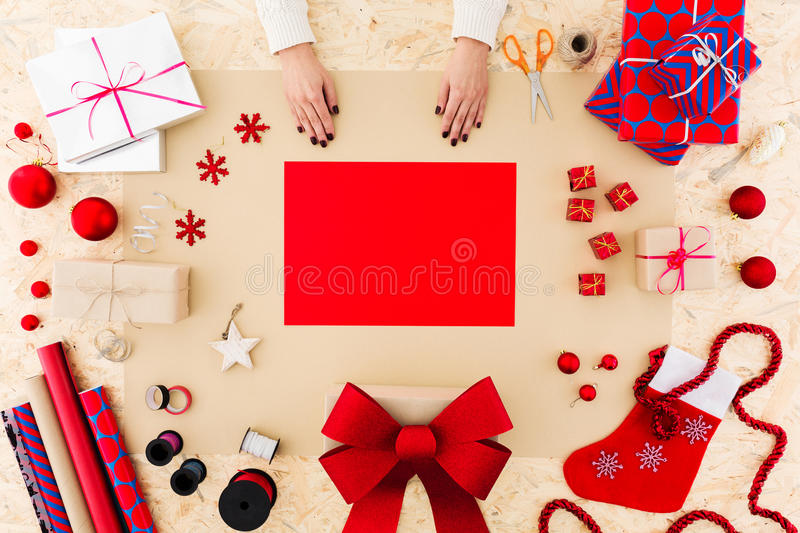 Christmas card for family. Young woman is making christmas card for family royalty free stock image