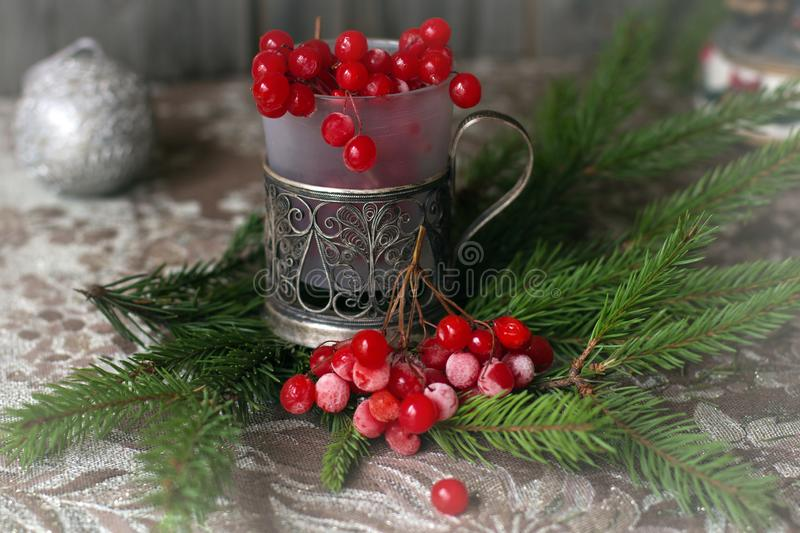 Christmas still life with fir-tree branches and red berries. Christmas card with fir-tree branches and the red frozen berries royalty free stock photo