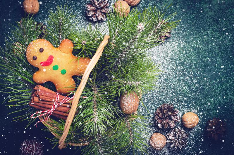 Christmas card with gingerbread man and coniferous branches in b royalty free stock image