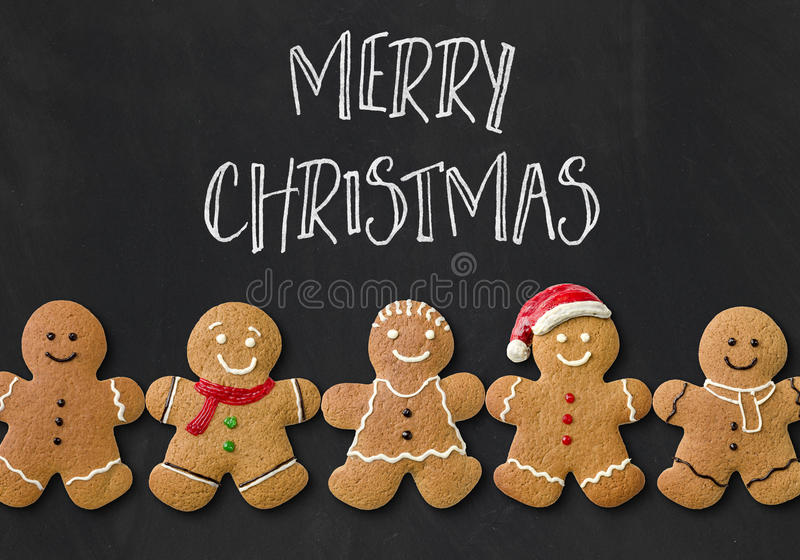 A christmas card with gingerbread men. Christmas card with gingerbread men royalty free stock image