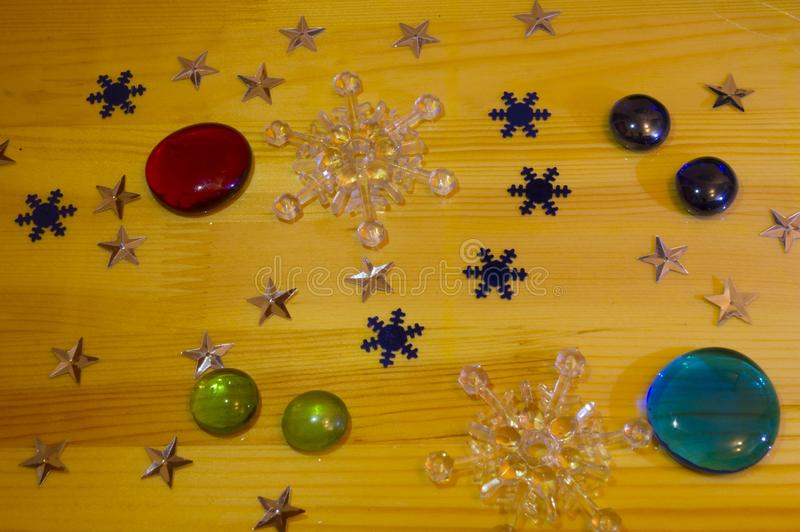 Christmas card happy New year, on a wooden table are Christmas toys. And snowflakes royalty free stock photography