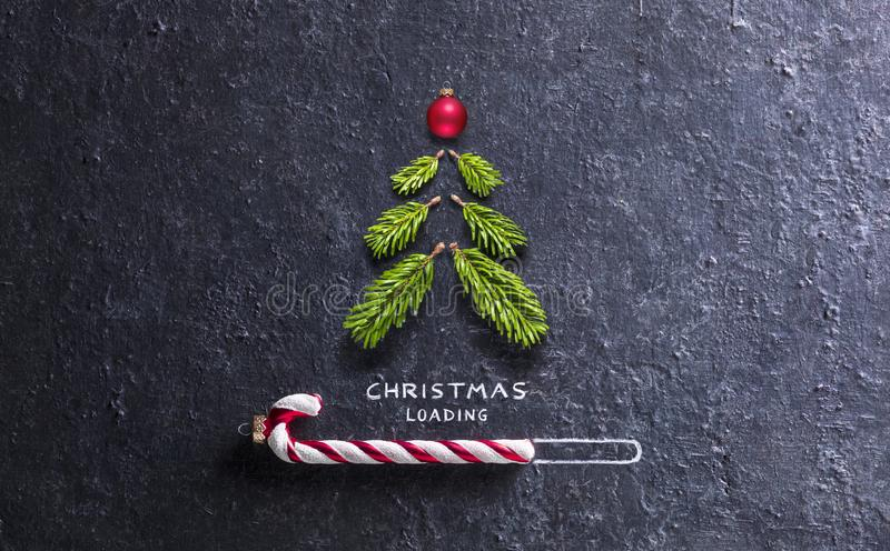 Christmas Card - Loading Concept - Tree And Candy Canes royalty free stock photos