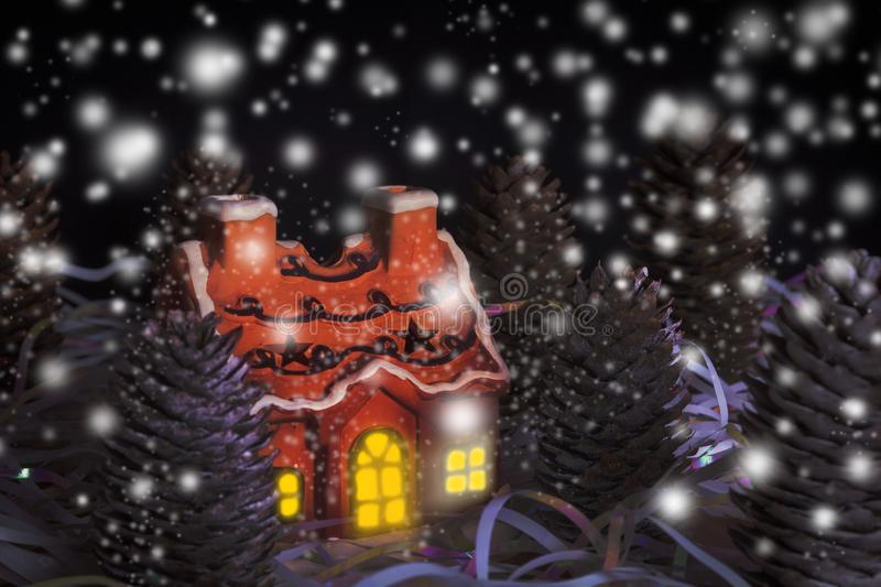 Christmas card of night forest with house, light of window and s stock photo