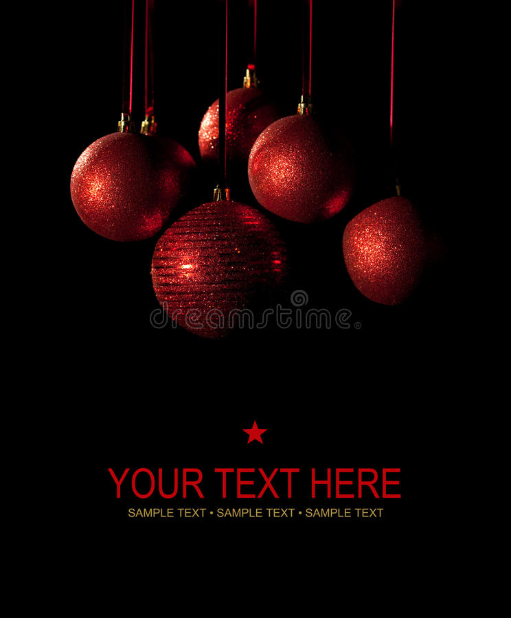 Christmas card - red balls on black background. Christmas card - red xmas balls on black background royalty free stock images