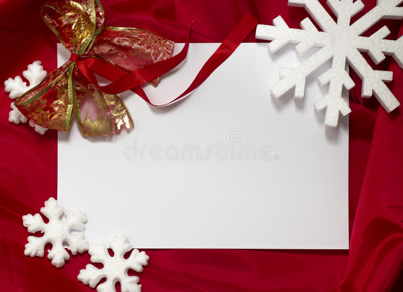 Christmas card. Red Christmas card, red christmas ornaments and seasonal greetings. White empty card for your text