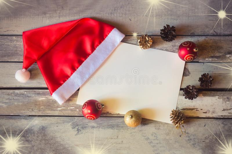 Christmas card with Santa hat and christmas decorations royalty free stock photos