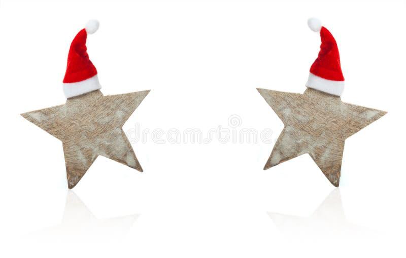 Christmas card, Stars with Christmas hats. Christmas card, Two Stars with Christmas hats royalty free stock photography