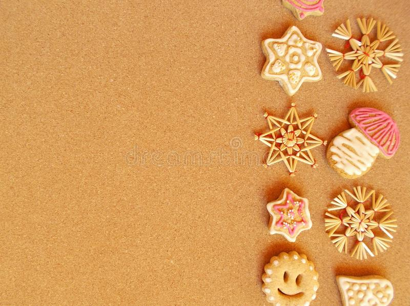 Christmas card - straw ornaments and gingerbread stock photos