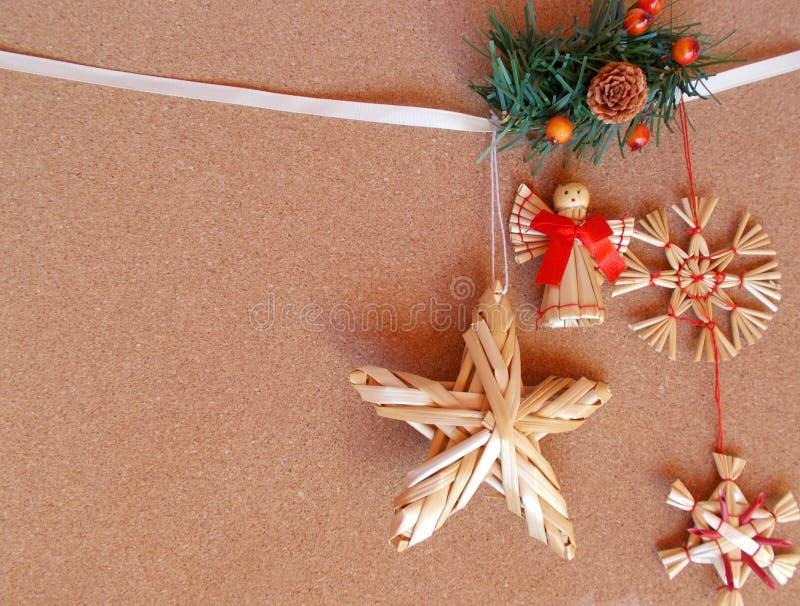 Christmas card - straw ornaments royalty free stock photos