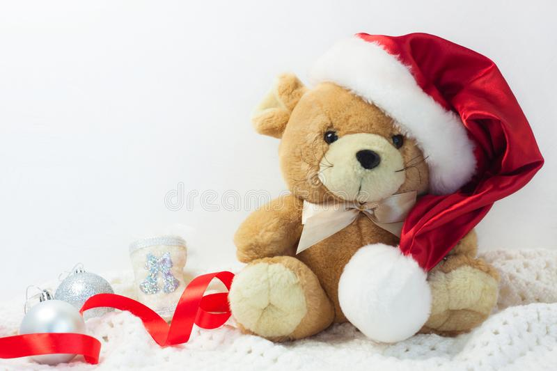 Christmas card with symbol of the year 2020 a rat in a red Santa hat on a white background royalty free stock photo