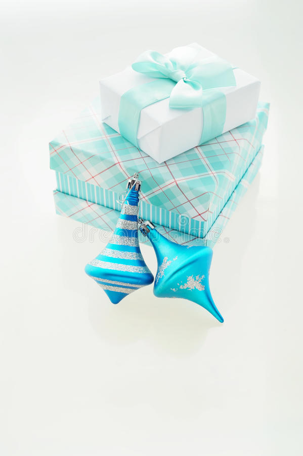Christmas Card with turquoise x-mas balls and gift boxes royalty free stock photo