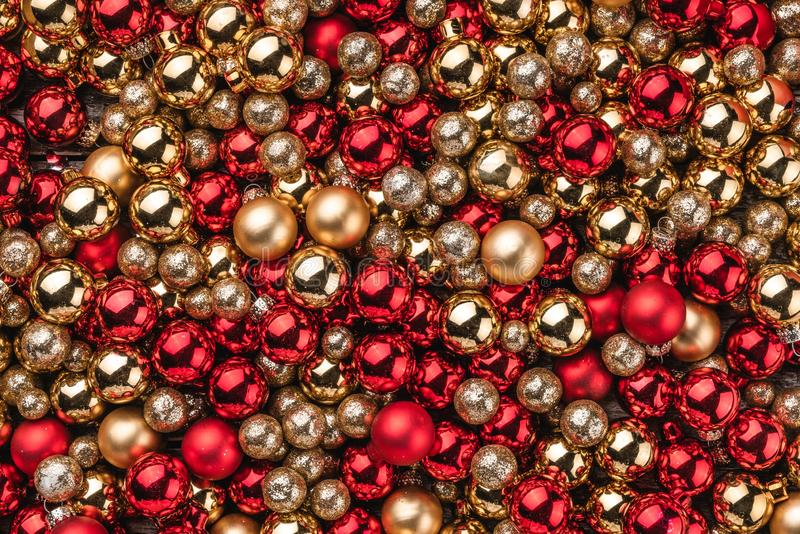 Christmas card. Wallpaper of red and gold baubles. Top view.  stock image