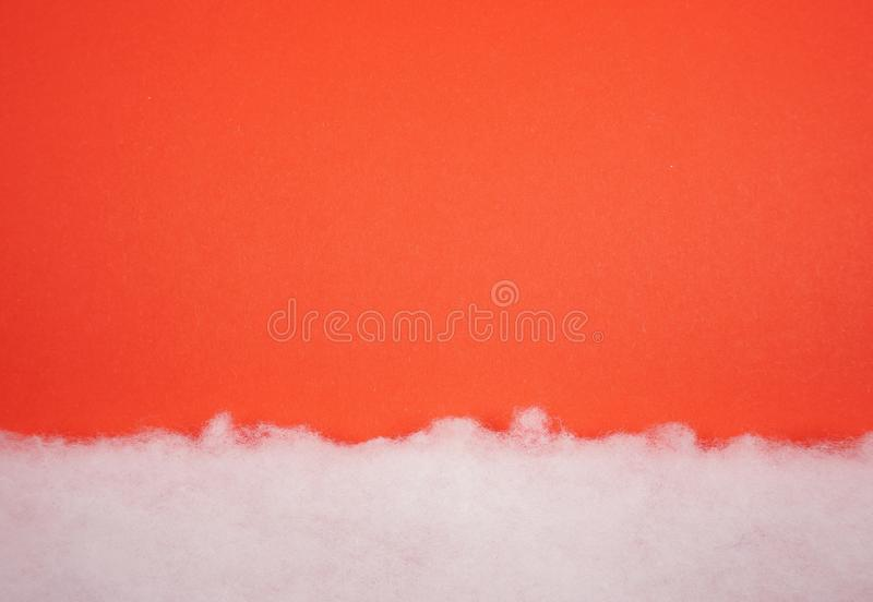 Christmas card with white cotton texture snow blanket, is soft, fluffy wadding, cotton at red background. Just for an invitation or wallpaper etc royalty free stock photos