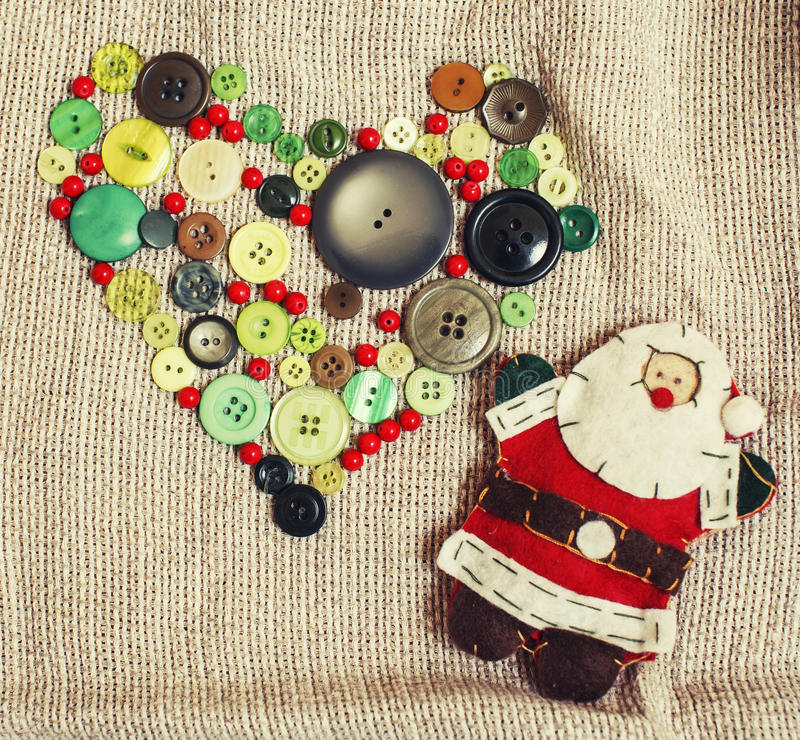 Christmas card wooden vintage with handmade gifts. Toys, cookie, snowman, santaclaus, button heart warm winter home stock photo