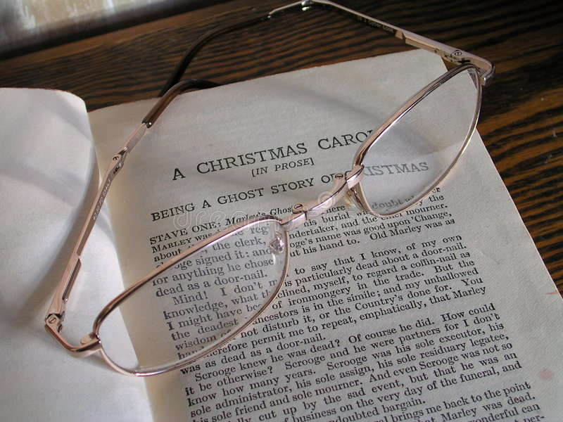A Christmas Carol. A Christmas story with glasses resting on book