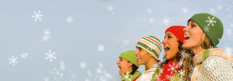 Christmas carol singers. Group of happy christmas carol singers stock photo