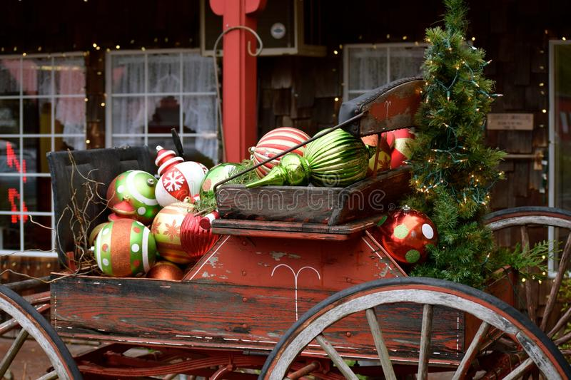 Christmas Cart. Its the season with the Christmas cart full of oversized ornaments bringing festive feeling stock image