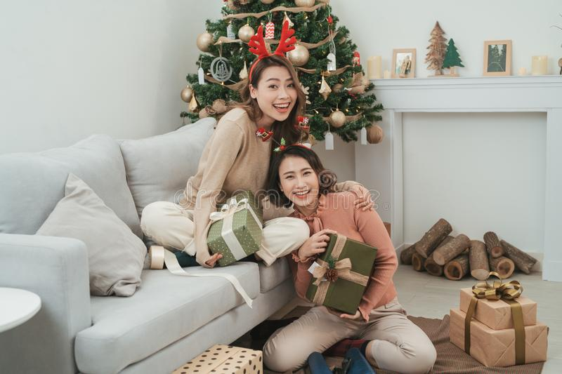 Christmas celebration. Friends with Christmas Gifts . New Year party stock photo