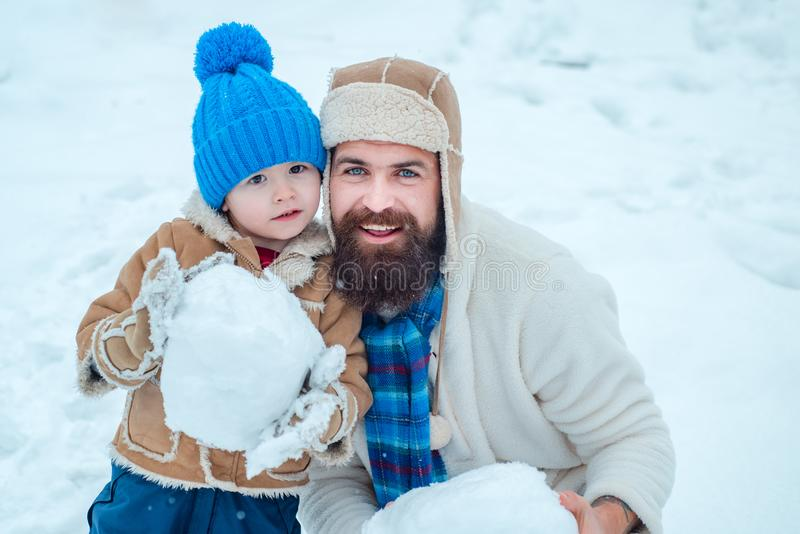 Christmas Celebration holiday. Father and son play in winter clothes. Happy father and son play on winter Christmas time stock images
