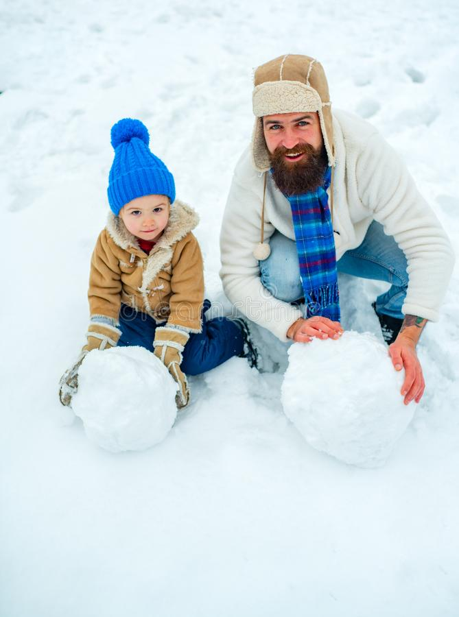 Christmas Celebration holiday. Fathers day. Christmas holidays. Father and son play in winter clothes. Winter portrait. Of dad and child in snow Garden stock images