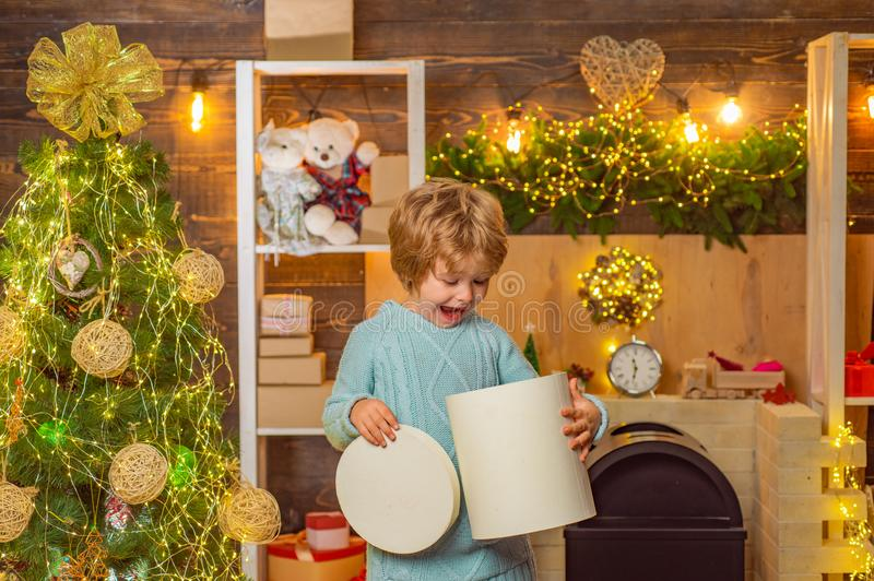 Christmas Celebration holiday. New year Christmas concept. Funny kid holding Christmas gift. Child with gift. Models stock images