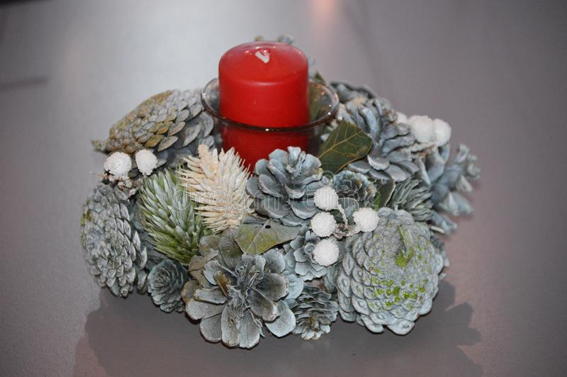 Christmas Centerpiece Red Pillar Candle Holiday Decoration Pine Cones royalty free stock photo