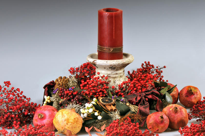 Christmas Centre-piece. With red candle stock image