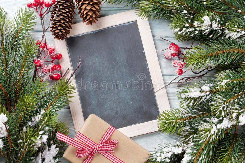 Christmas chalkboard, tree and gift box stock images
