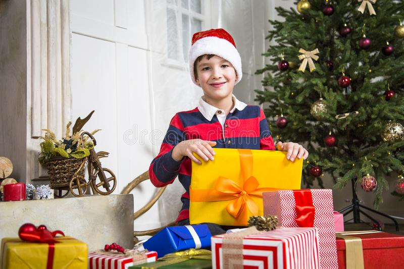 Christmas chikd with present box. royalty free stock photos