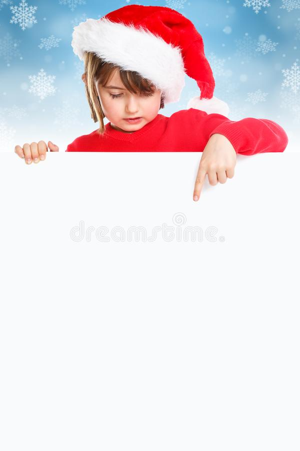 Christmas child kid girl Santa Claus pointing empty banner portrait format snow copyspace royalty free stock images