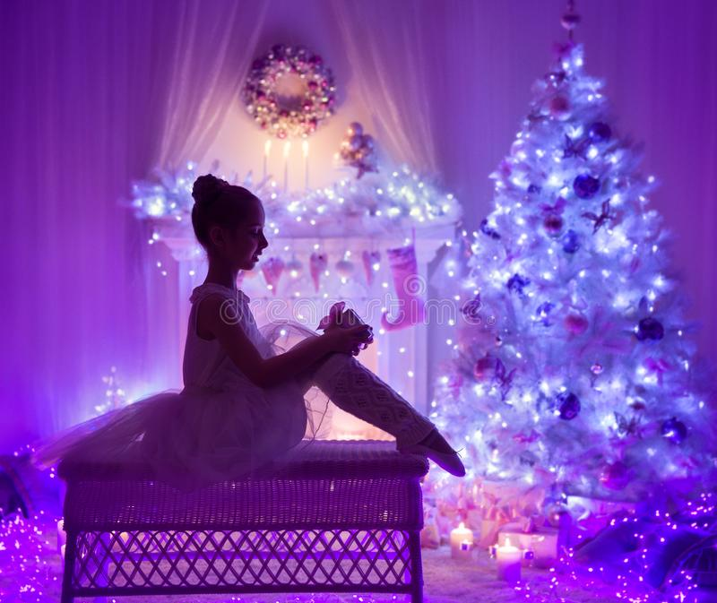Christmas Child Open Present Gift Box, Xmas Tree Fireplace royalty free stock images