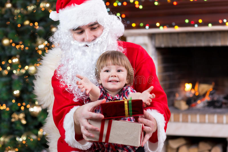 Christmas and childhood concept - smiling child royalty free stock image