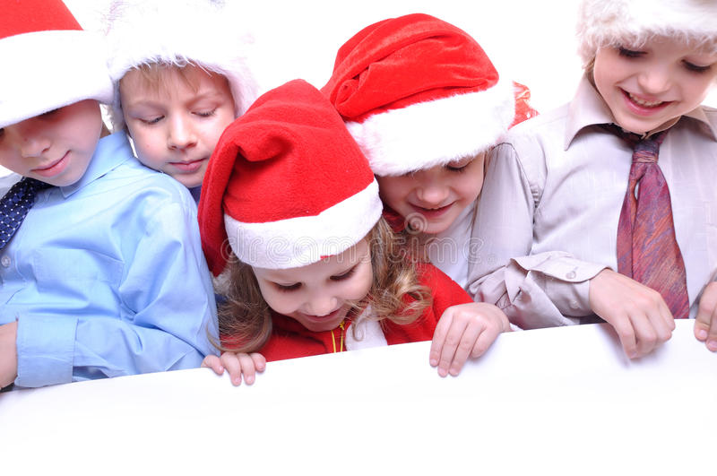 Christmas children with a banner stock images