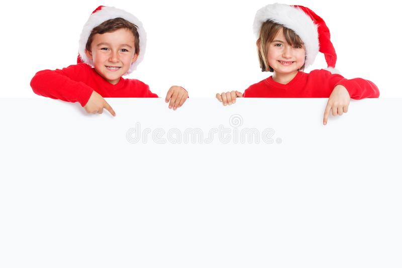 Christmas children kids Santa Claus pointing happy empty banner isolated on white copyspace copy space. Young stock photo