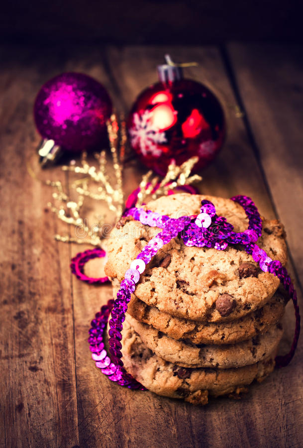 Christmas chocolate cookies tied with festive ribbon on wooden stock photography