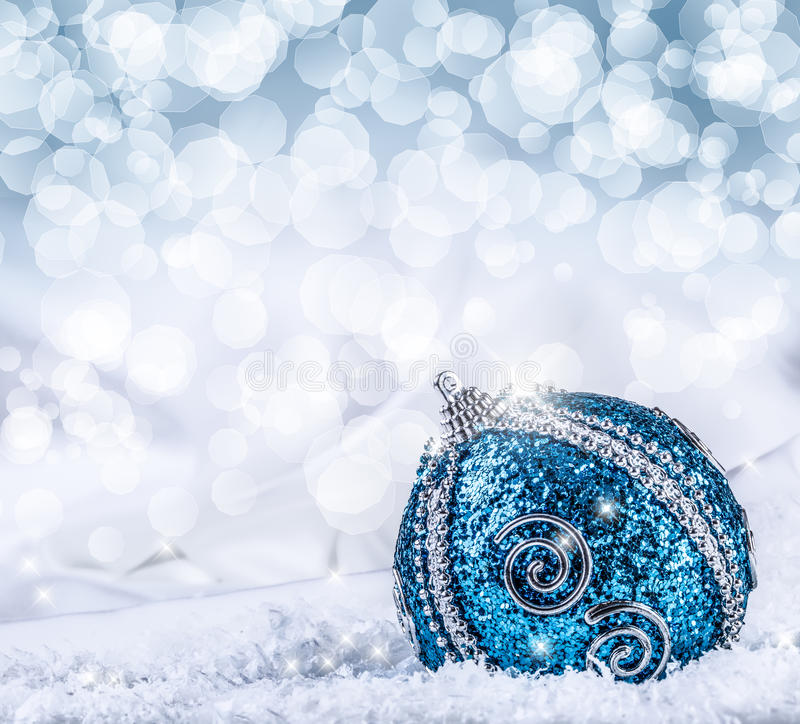 Christmas. Christmas blue balls and silver ribbon snow and space abstract background. Christmas time stock photography