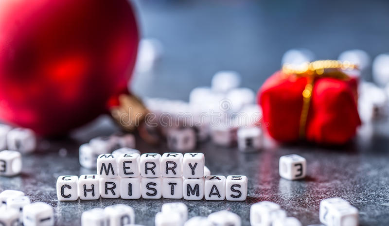 Christmas. Christmas Time. Christmas decoration.The words Merry Christmas with red christmas decorations.  stock photos