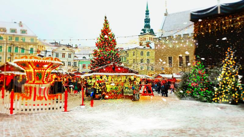 Christmas in the city  holiday new year in Tallinn old town square Christmas tree decoration light market place Estonia royalty free stock image