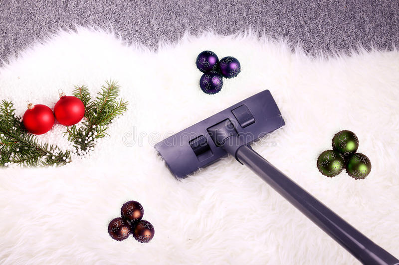 Christmas cleaning. Christmas vacuuming and cleaning house royalty free stock image