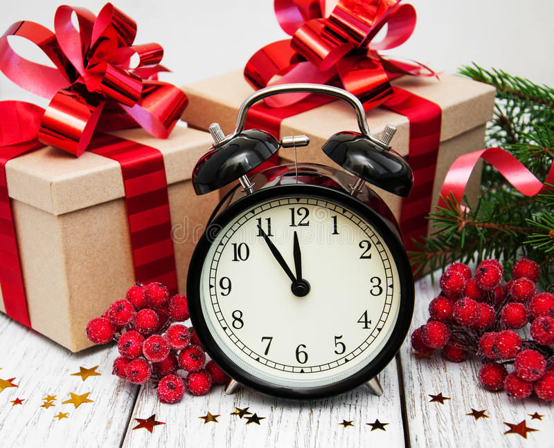 Christmas clock on a wooden background royalty free stock photo