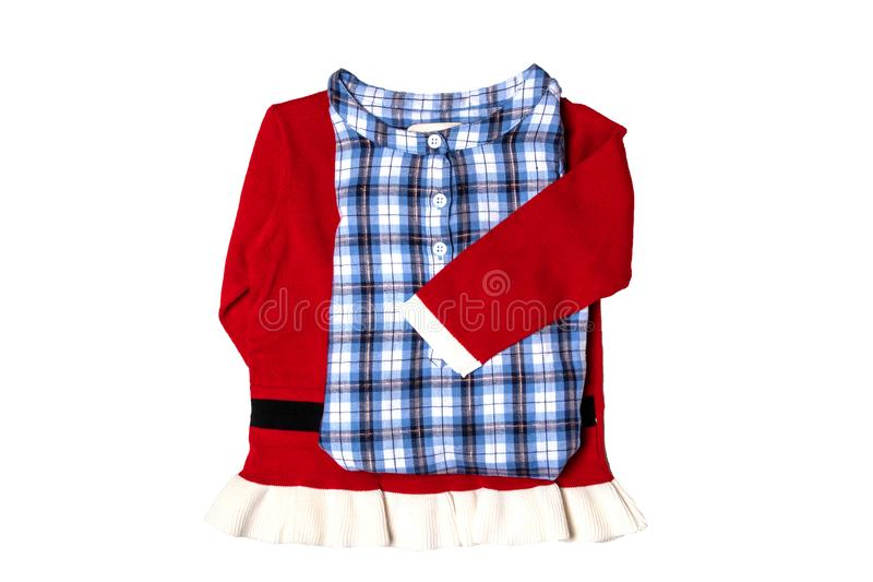 Christmas clothes. Blue checkered kids girl shirt with child girl sweater or jumper in Santa Claus design. stock photos