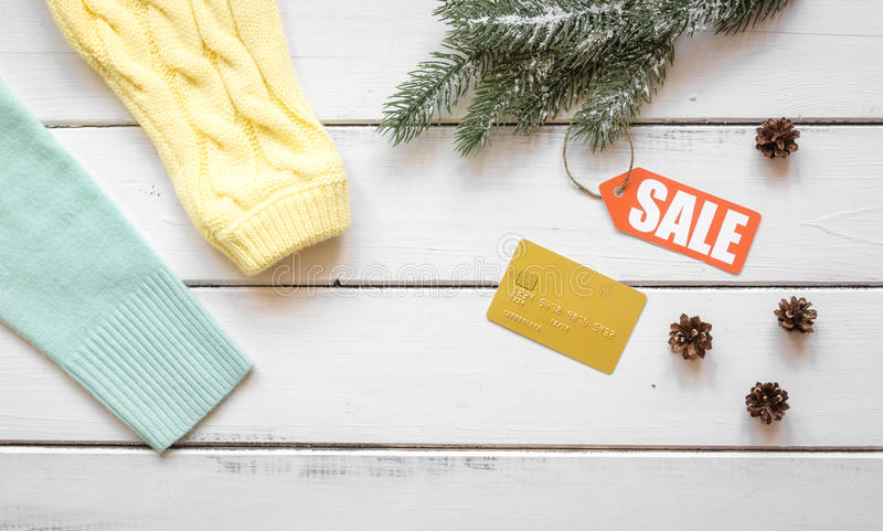 Christmas clothing sale on wooden background top view.  royalty free stock photo